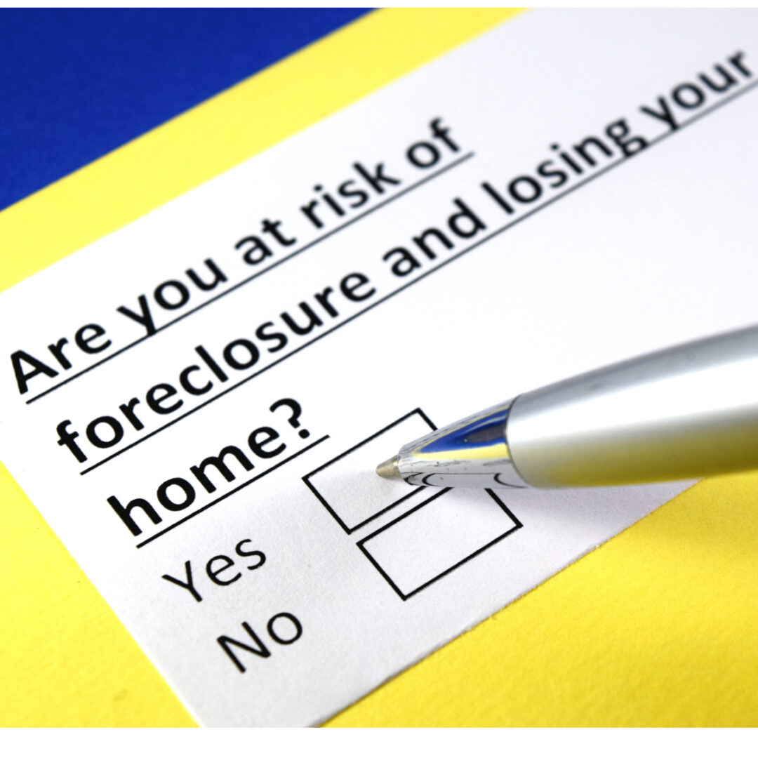 Sign that asking if you are at risk of foreclosure and losing your home. Its showing a pen checking the yes box