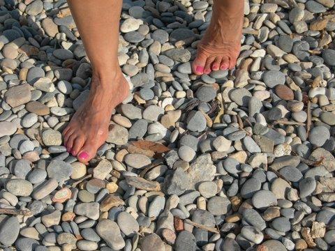 Self-Reflexology pressure on pebbles
