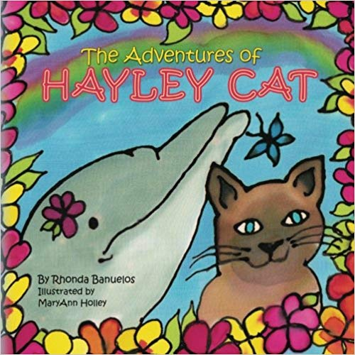 A children's book cover with the protagonist cat and a dolphin
