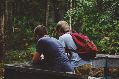 Two teen boys getting ready for a hike