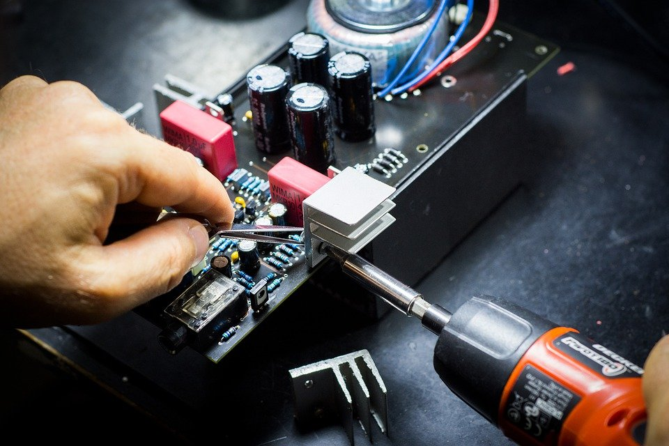 A person working on a PCB