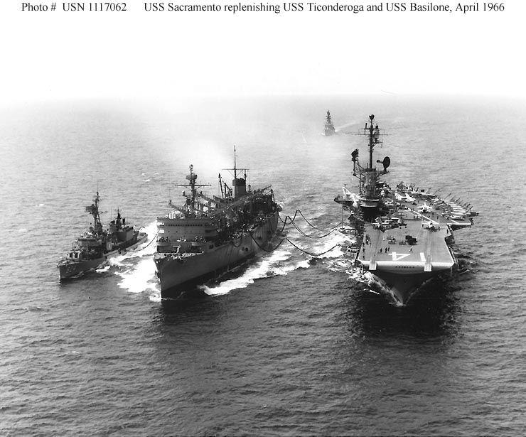 Basilone to left, Sacramento (AOE-1) in the middle, Ticonderoga (CVA-14) to the right.  South China Sea, Apr, '66