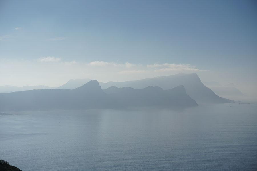 Hazy shore cliffs