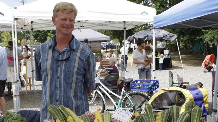 Urban farmer Richard Dickinson sells vegetables at the Lent's International Farmers Market in East Portland, Ore. on July 12, 2015. (Gosia Wozniacka / Associated Press)