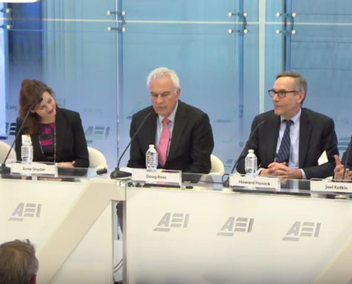 Joel Kotkin (right) moderates the discussion at the AEI Conference on Localism in America