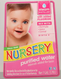 Water for infant formula with fluoride for stronger teeth at the dentist for kids