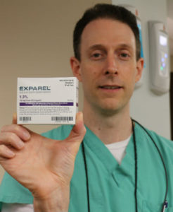 Dr. Nick Calcaterra, dentist in Orange, Connecticut, holding Exparel before performing wisdom teeth extraction surgery.