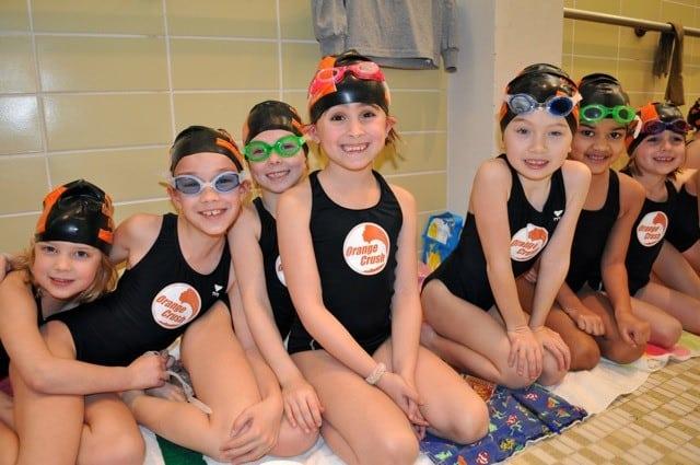 young swimmers on the girls orange crush swim team