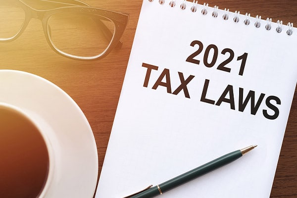 Note book with 2021 Tax Laws written in fat black marker