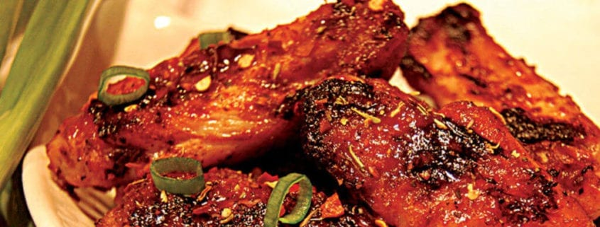 Enjoy these Fired Up Chicken Wings with a Jerk Marinade that are cooked with the Rainford Method. Ingredients 1⁄2 cup (125 ml) canola oil 1⁄4 cup (60 ml) Jerk Marinade (see below) 2 Tbsp (30 ml) chili powder 2 Tbsp (30 ml) onion powder 1 Tbsp (15 ml) garlic powder 1 Tbsp (15 ml) smoked paprika 1 Tbsp (15 ml) freshly ground black pepper 1 jalapeño chili (for less heat, seed the chili) 1 tsp (5 ml) kosher salt 1⁄2 tsp (2 ml) ground ginger 2 lb (1 kg) chicken wings Fired Up Chicken Wings Instructions Combine the oil, jerk marinade, chili powder, onion powder, garlic powder, smoked paprika, black pepper, jalapeño, salt and ground ginger in a large bowl. Add the chicken wings and toss to coat evenly. Refrigerate for at least 2 hours or up to 24 hours. Fire up your charcoal. Set up the EGG for direct cooking at 350°F/177°C. Remove the wings from the marinade, shaking off the excess. Pat the wings dry with paper towels. Grill the wings, turning once halfway through cooking, for 20 to 30 minutes or until golden and the juices run clear. Makes 2 main course servings or 10 appetizer servings. Jerk Marinade Ingredients 3⁄4 cup (185 ml) white vinegar 1⁄2 cup (125 ml) orange juice 1⁄4 cup (60 ml) olive oil 1⁄4 cup (60 ml) soy sauce 1 lime, juiced 2 Tbsp (30 ml) garlic powder 1 Tbsp (15 ml) dried thyme leaves 1 Tbsp (15 ml) ground allspice 1 1⁄2 tsp (7.5 ml) dried red chili flakes 1 1⁄2 tsp (7.5 ml) dried ground sage 1 1⁄2 tsp (7.5 ml) freshly ground black pepper 1 tsp (5 ml) kosher salt 3⁄4 tsp (4 ml) ground cinnamon 3⁄4 tsp (4 ml) ground nutmeg 1 cup (250 ml) chopped onion 3 green onions, finely chopped 1 Scotch bonnet chili, seeded and chopped Jerk Marinade Instructions Blend all ingredients together in a food processor until smooth. Makes 13⁄4 cups (450 ml). Recipe from Big Green Egg and courtesy of Robert Rainford.