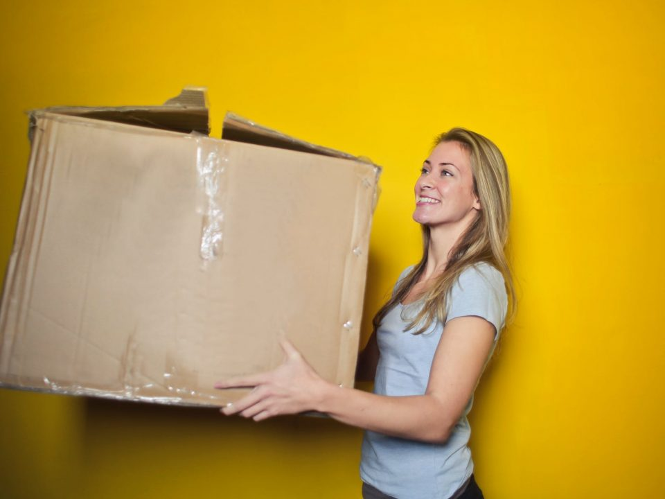 woman holding a packing box