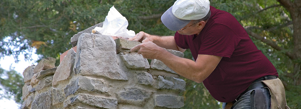 Chimney mason repointing stone grout