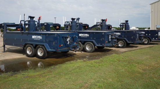 Blue Mitchell Industries gravel packing trailers in a row