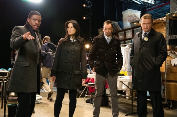 Detective Bell, Joan Watson, Sherlock Holmes and Captain Gregson (L - R)