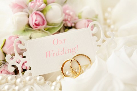 Our Wedding Image - Rings in Beautiful Floral Setting