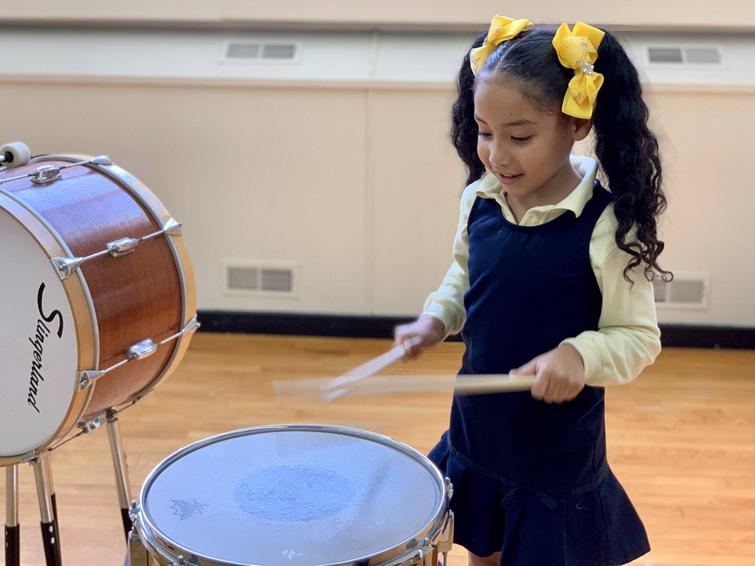 Student playing snare