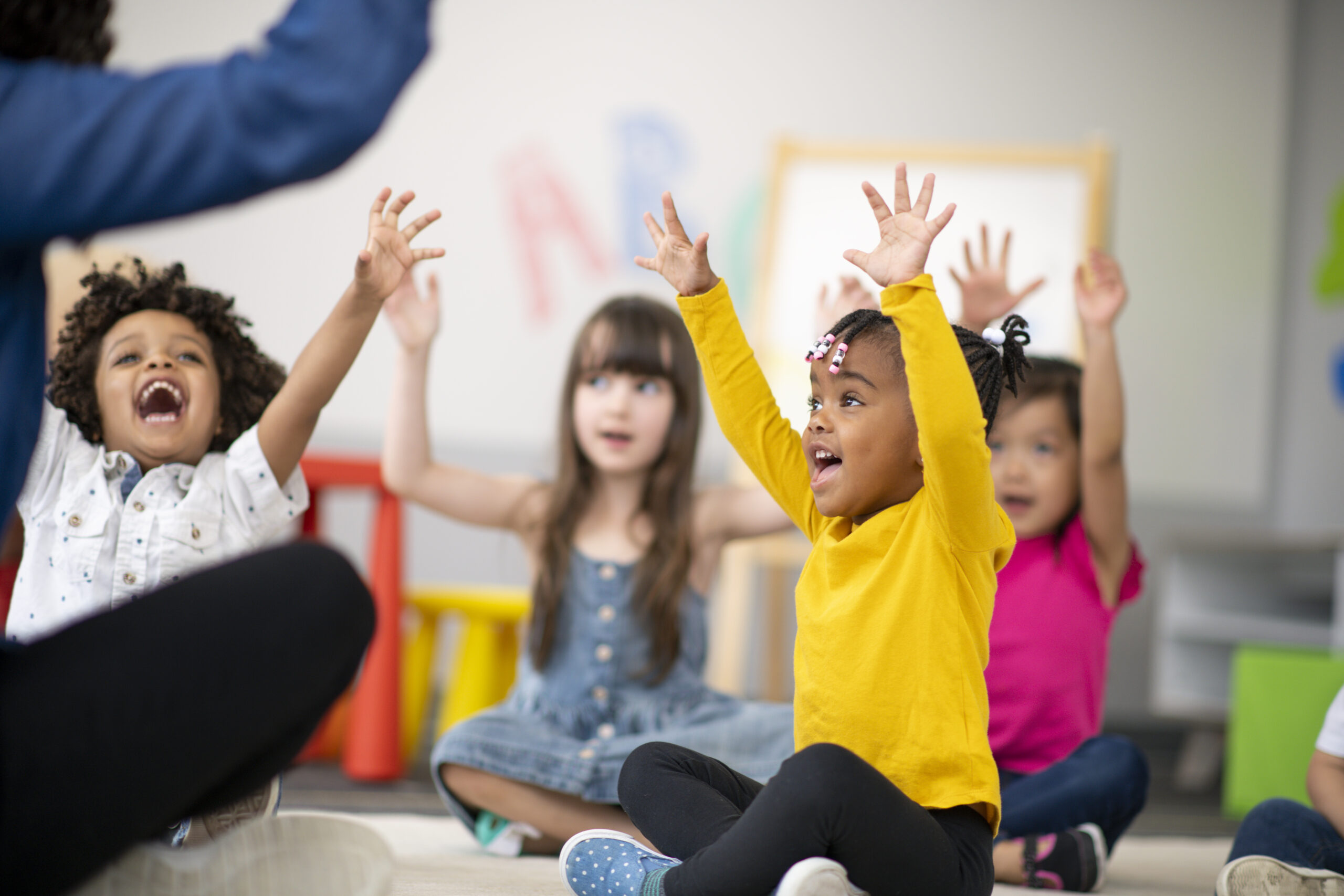Multi-ethnic group of preschool students in class