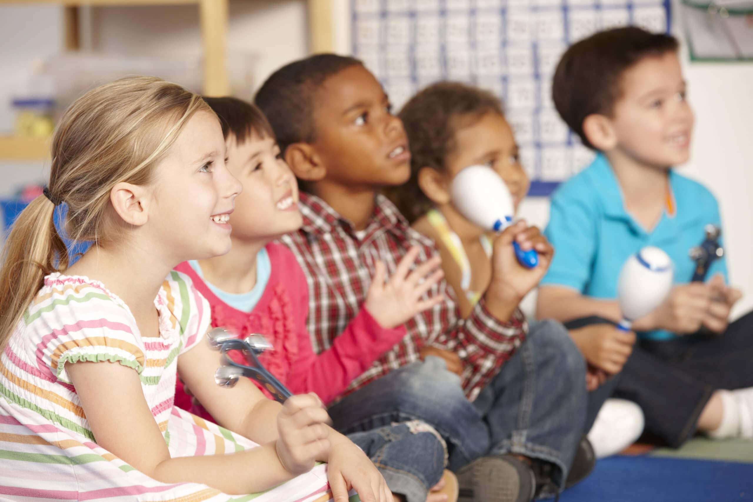 Group Of Elementary Age Schoolchildren In Music Class