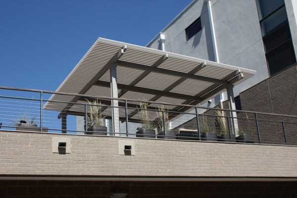 A high area with potted plants and a patio cover
