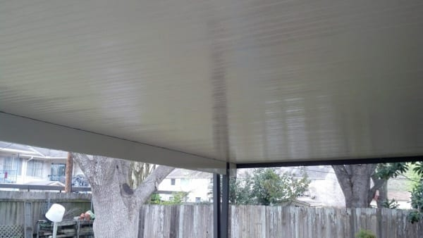 Ceiling view of a white patio cover