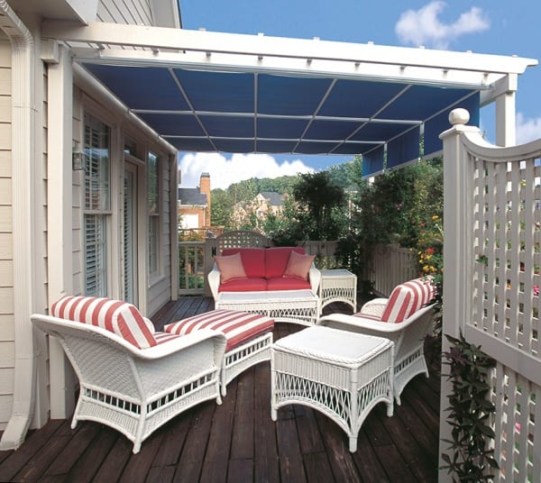 A red and white-themed patio with a blue cover
