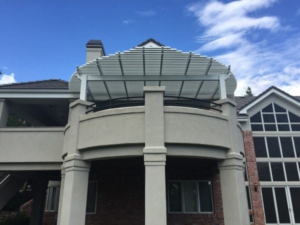 An elevated porch with a round cover