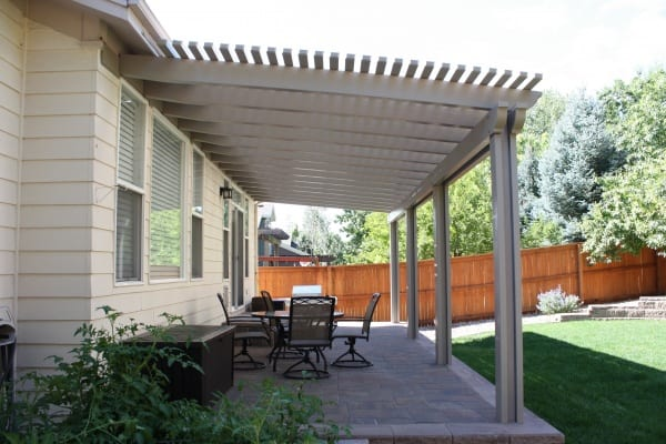 A patio with a dining table set and a beautiful cover
