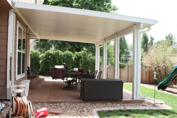 A huge home with an installed white cover on its patio