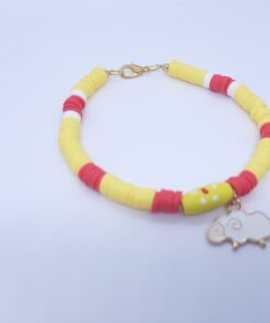 Yellow bracelet with cheep charm