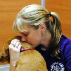 Kristie consoling a rescue dog from Puerto Rico