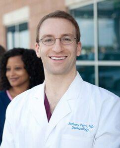 Dr. Perri Headshot in White Coat