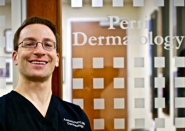 Dr. Perri Next to Perri Dermatology Office Door