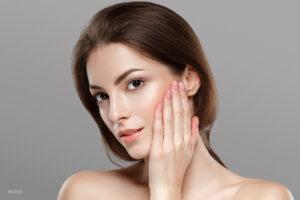 Woman Touching Soft Skin on Cheek