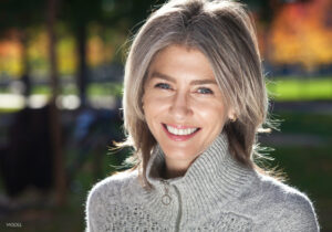 Older Caucasian Female Smiling Outside