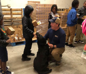 Capital Prep School Student says hello to Ace, our Scent Detection K9