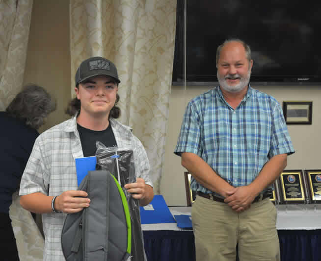 Ethan Lavigne of Gardiner, Maine receiving a lifetime Maine fishing license given by A Partner in Technology.