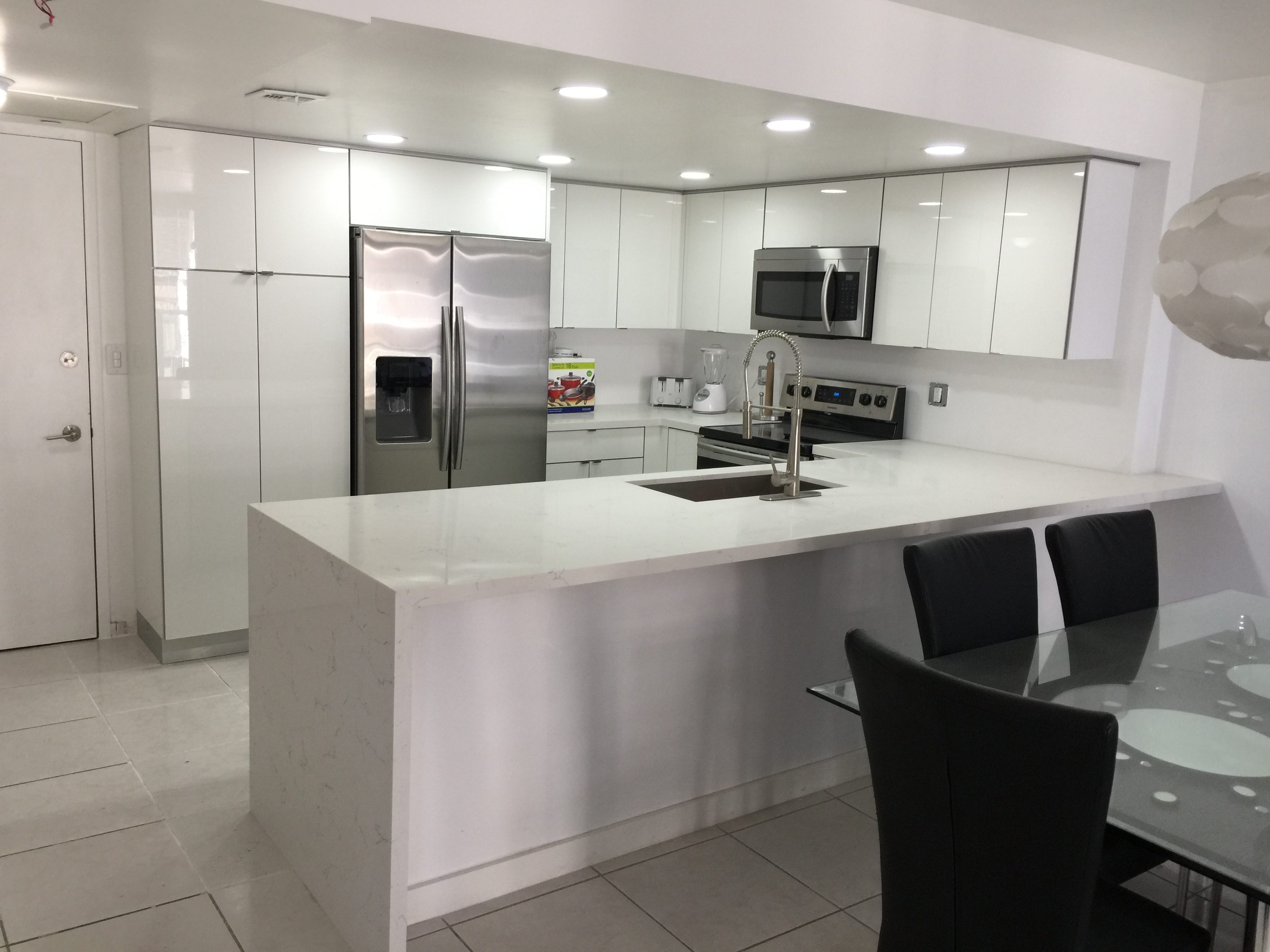 Modern White Kitchen Cabinet Installation - Universal Cabinets and Closets