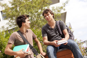 bigstock-two-young-student-talking-at-t-15474467