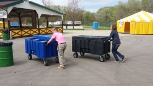 """Linda & Diana working hard to set up for the """"Between the Bluffs Beer, Wine, & Cheese Festival"""","""
