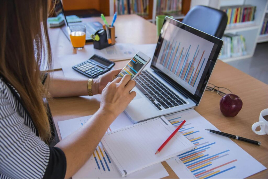 woman working on marketing reports