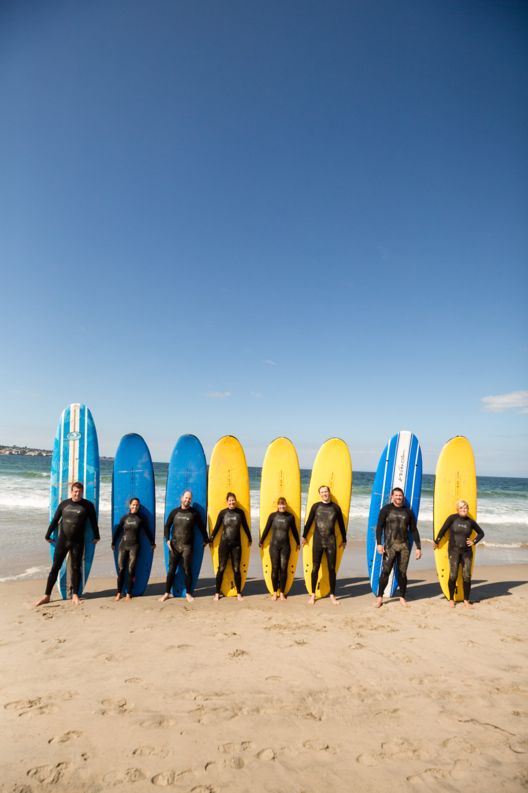 Incentive Group in Front of Surfboards