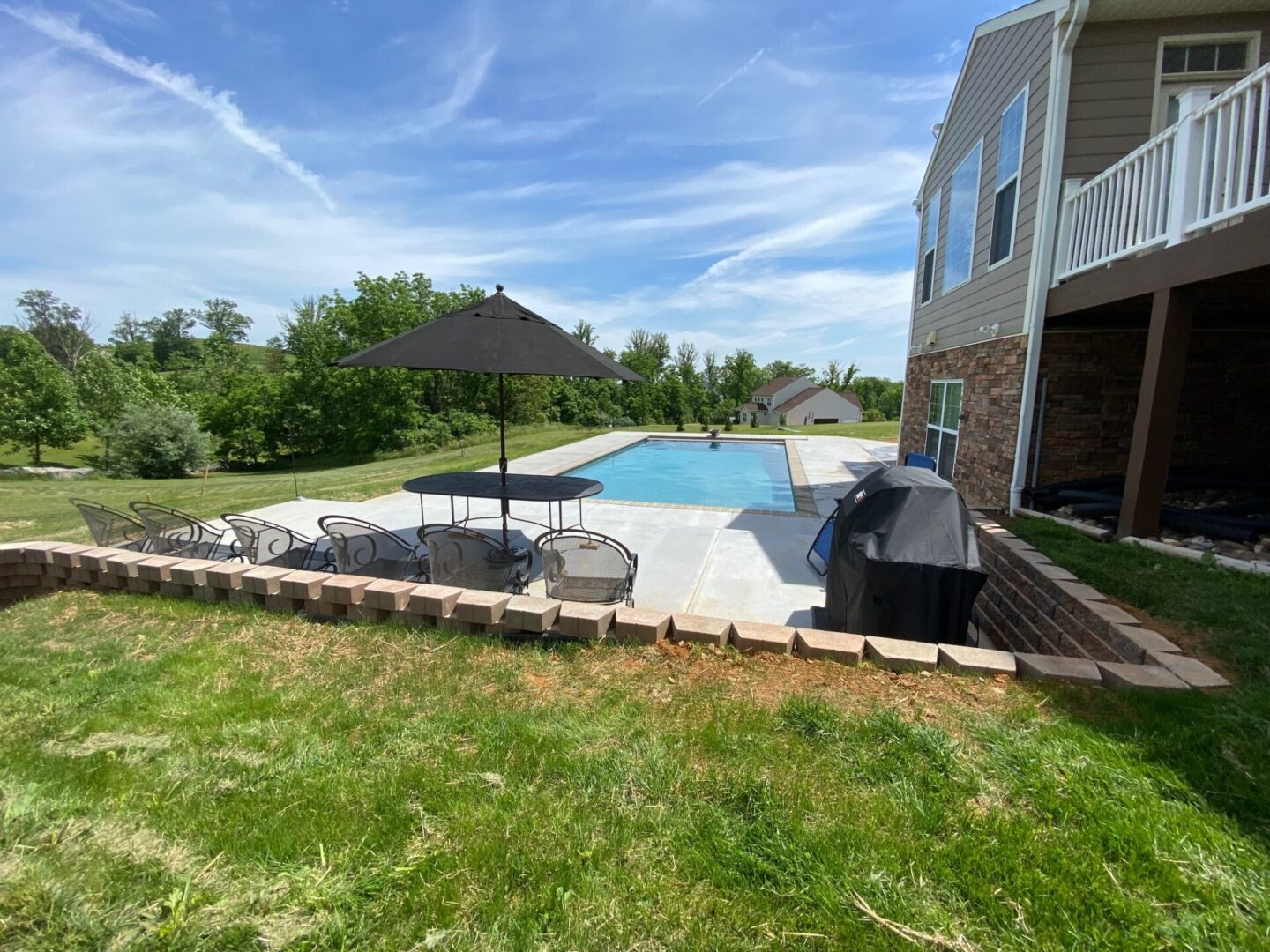Pool with brushed gray concrete deck
