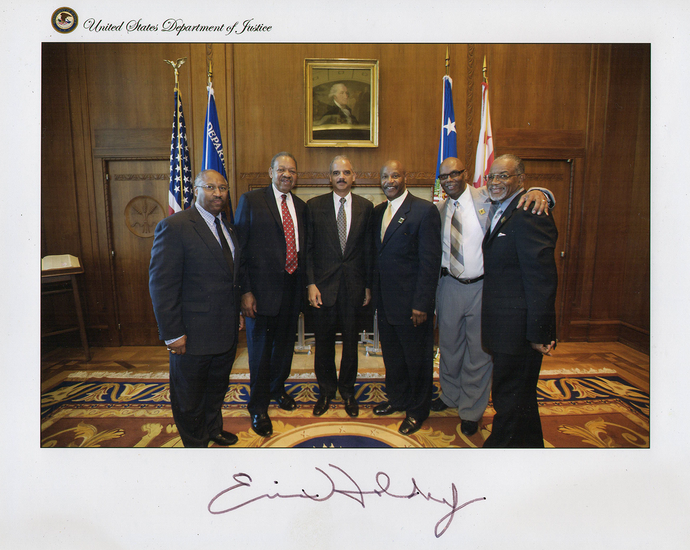 Former U.S. Attorney General Eric Holder and members of ACM