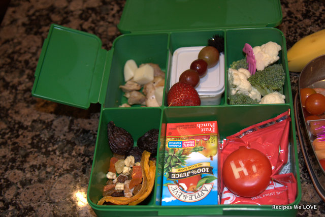 chicken & cheese, fresh fruit, hummus (in the what box) fresh veggies, dried fruit, a 100% juice box, and fruit snack.