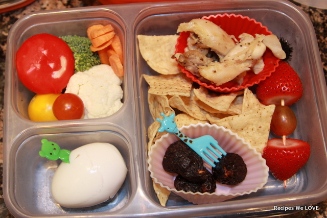 cheese, veggies, chips, chicken, figs, fresh fruit, and hard boiled egg.