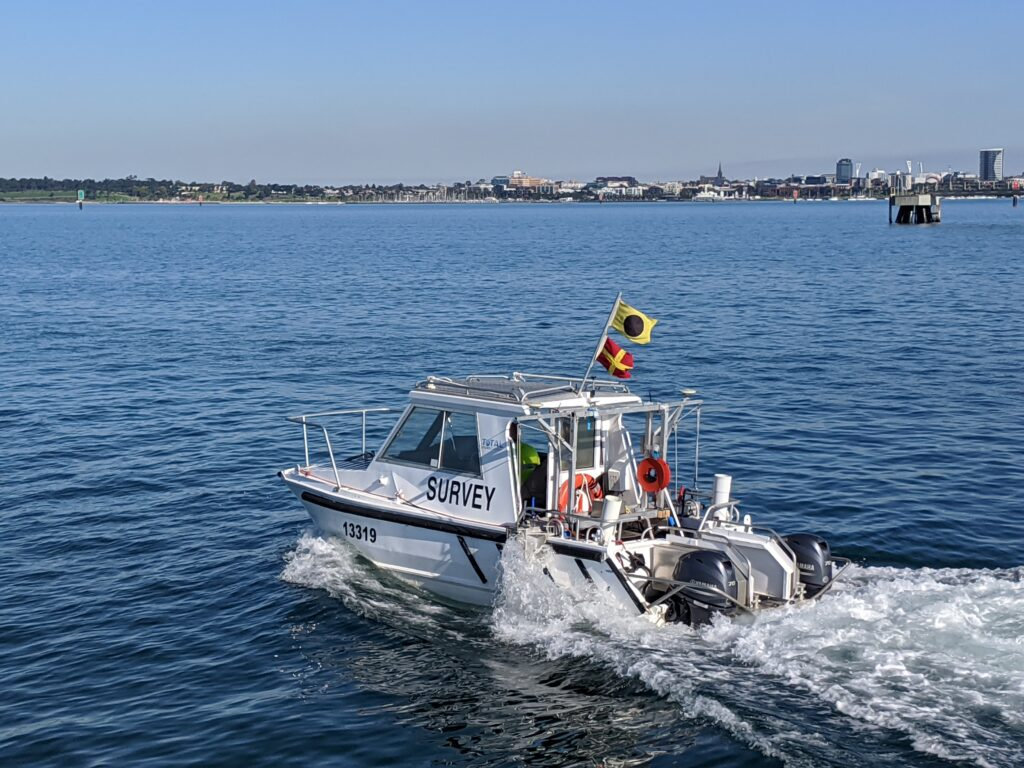 Hydrographic Boat surveying port for underlying sediments