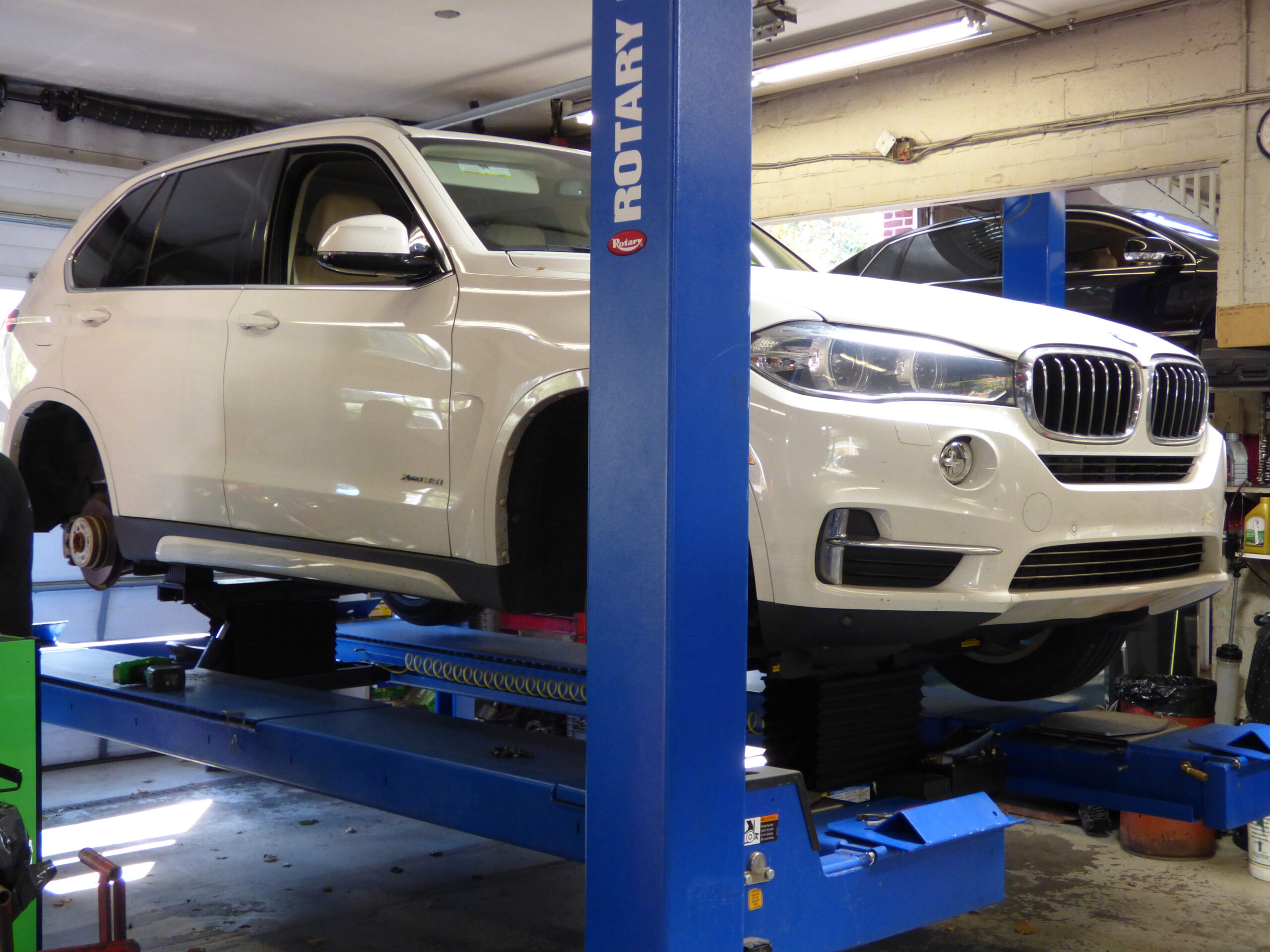 White BMW on lift at Imported Auto Center