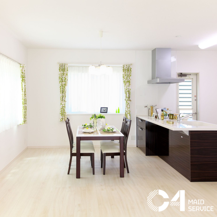 Clean kitchen with dining table at the center