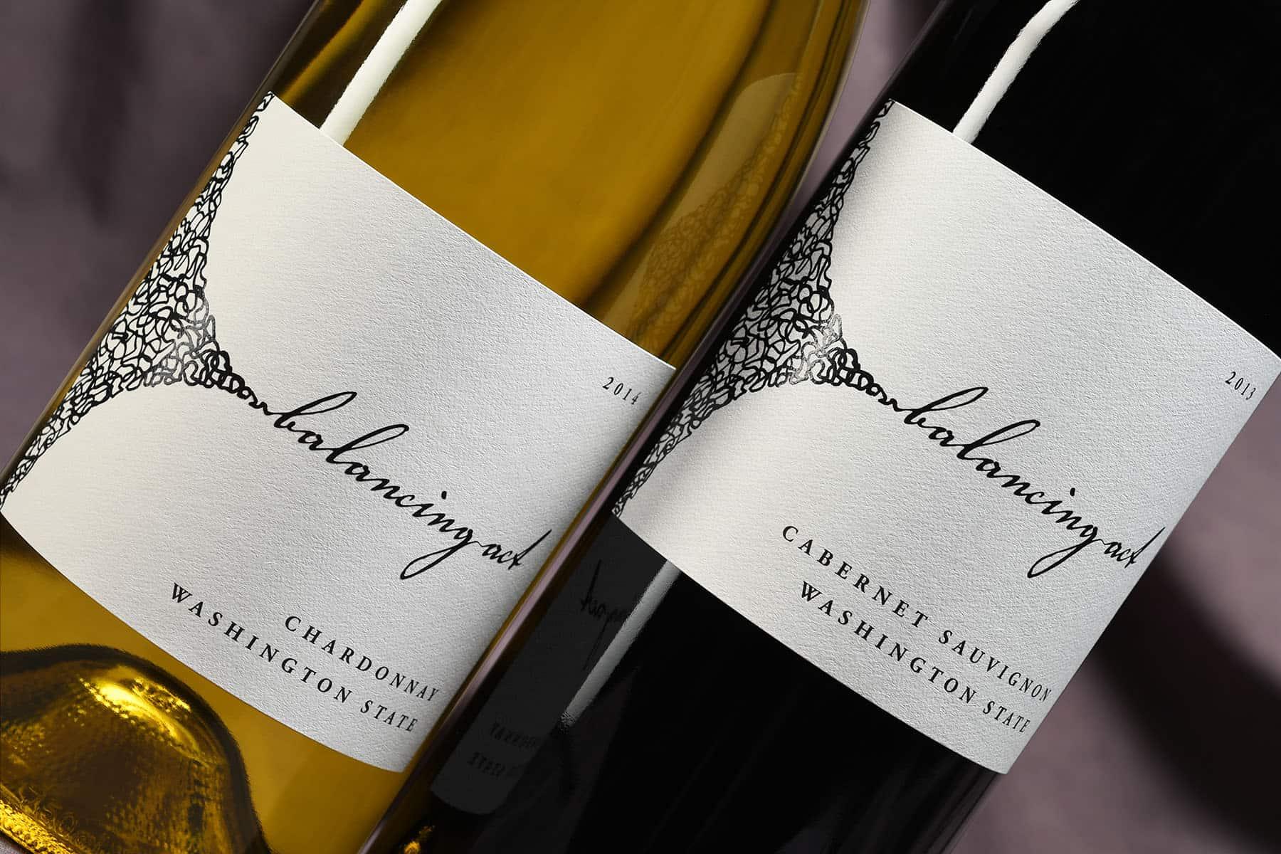 Balancing Act wine bottles close up