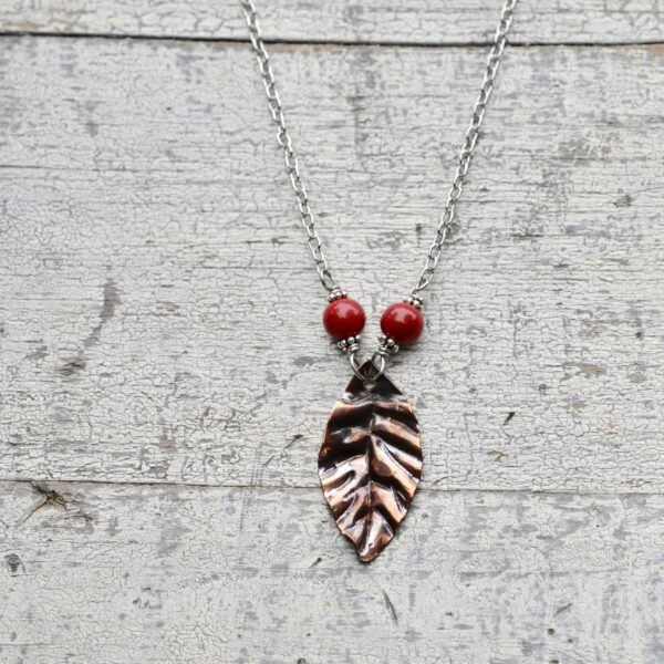 copper leaves pendant with red beads